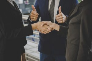 business people shaking hands finishing up meeting deals business concept 1150 2981