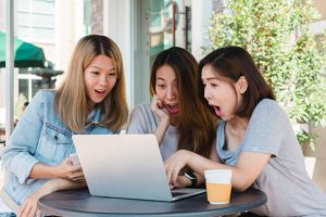 group happy asian women friends watching media content on line in laptop sitting in coffee shop 7861 822