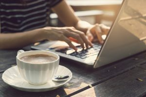 hand typing on key board laptop with cup of coffee 44943 352