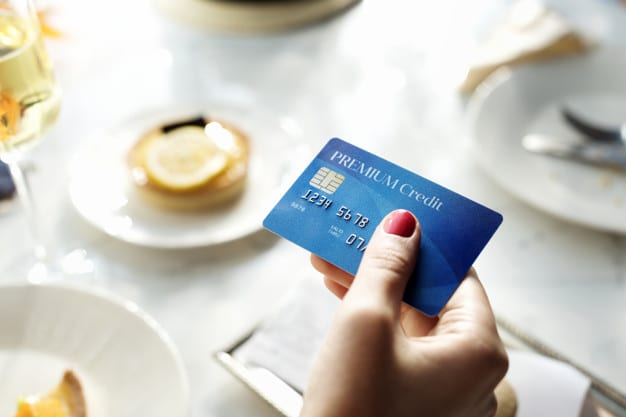 closeup of hand holding credit card 53876 55541